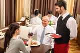 Business lunch executives toasting with red wine poster