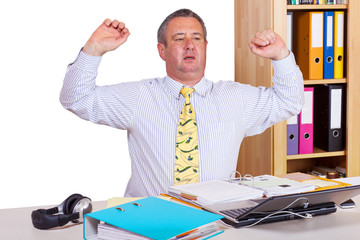 Businessman stretches and expands
