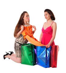 Girls enjoying shopping, having fun and lolling