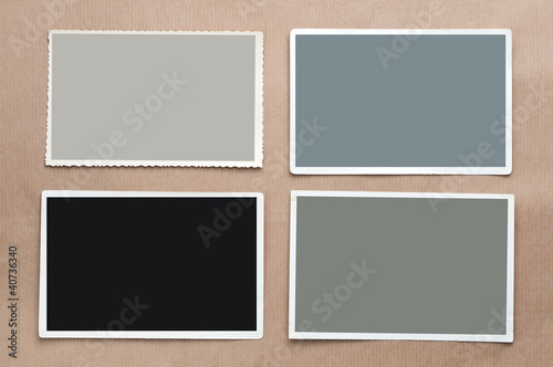 Set of four old, blank picture on gray cardboard background