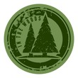 Green grunge camping stamp with firs.