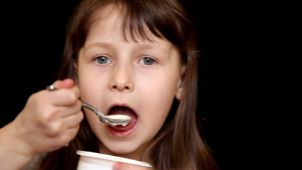 Girl eating a lollipop