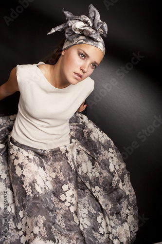fashion portrait of sensual young female on dark background