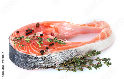 Red fish with spise and thyme isolated on white