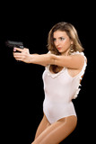 Hot young woman holding a gun