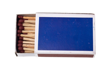 Matchbox full of matchsticks isolated on white background