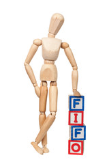 First In First Out - Figurine with the letters FIFO isolated