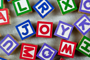 Wooden blocks forming the word JOY in the center