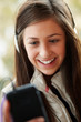 Teenage Girl Wearing Headphones And Listening To Music Wearing W