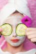 Young girl getting facial treattment at a spa