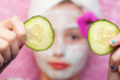 Cucumber slices with a facial mud mask at a spa