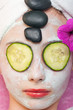hot stone therapy and a facial mask at a spa