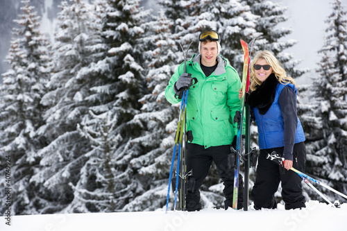 Young Couple On Ski Holiday In Mountains