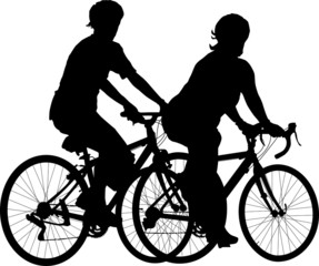 Two people riding on bikes