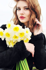 young beautiful girl with daffodils