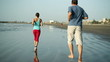 Young sport couple jogging on the beach, slow motion
