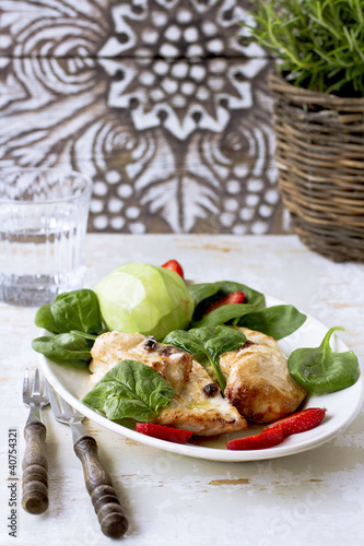 Baked chicken breast with strawberry and spinach