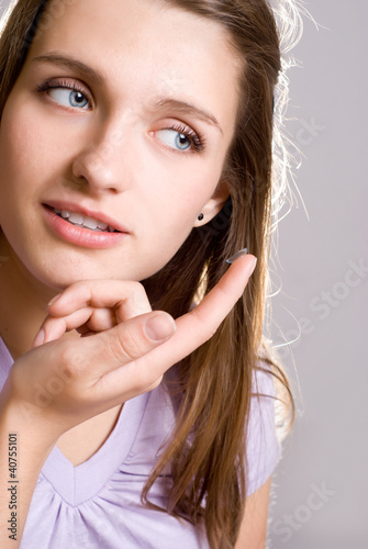 A girl holds a contact lens
