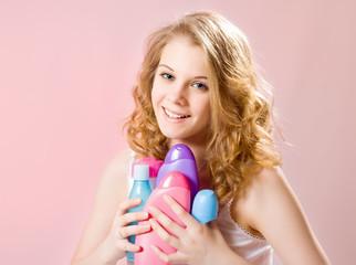 girl holds shampoos