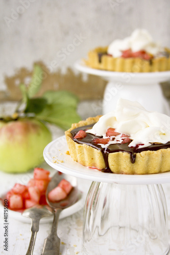 Cakes with chocolate, pears and whipped cream