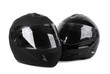 two black motorcycle helmets isolated