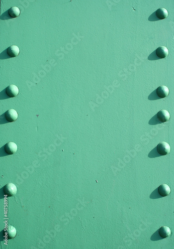 Steel girder with rivets