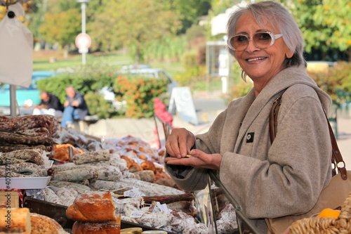 a senior woman  in an open-air market