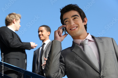 junior businessman on the phone outdoors