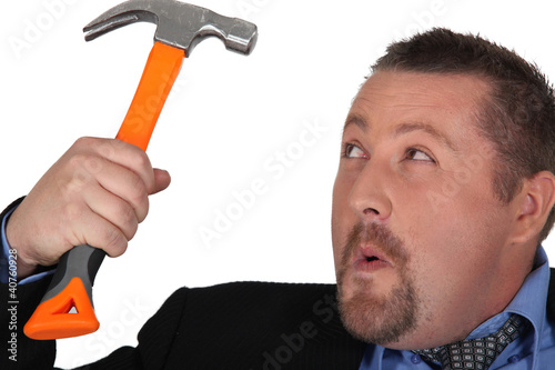 Businessman holding a hammer