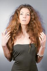 beautiful woman with long hair studio portrait