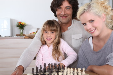 Family gathered by chess board