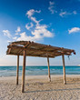 wooden canopy on the sandy beach and blue sky