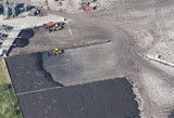 Aerial view of tractors at work in quarry