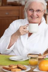 Senior woman at breakfast
