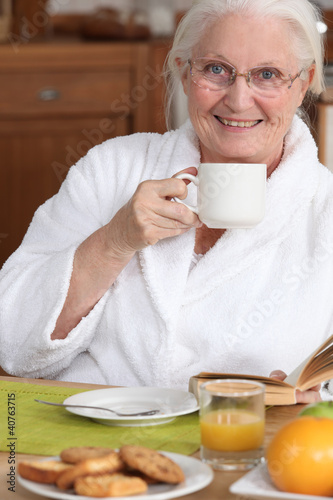 Senior woman at breakfast