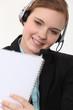beautiful blonde receptionist holding notebook