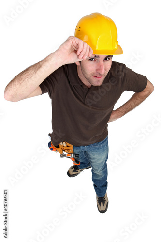 Happy builder touching hat