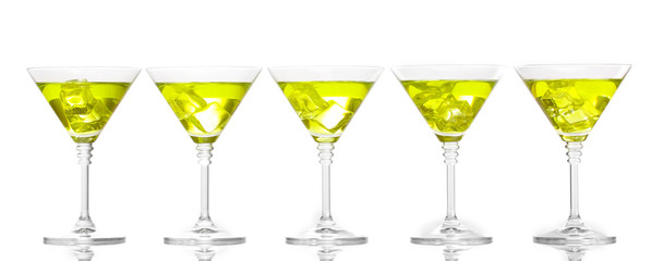 Yellow cocktail in martini glasses isolated on white