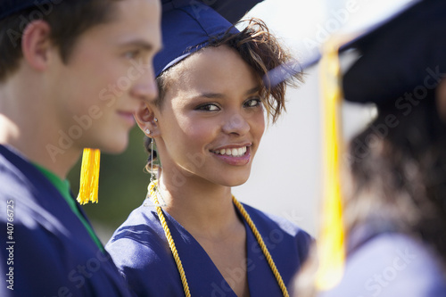 Graduate smiling in cap and gown