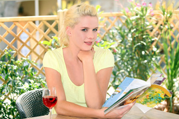 Woman sitting on a terrace with a glass of wine