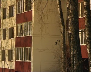 renovate apartment house. insulated walls  balconies. trees grow