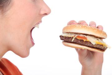 Woman eating cheeseburger