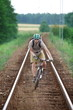 Off road biker having fun riding on railway track