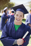 Smiling graduate carrying diploma