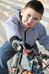 Portret of the boy on the bike