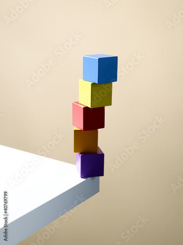 Stack of colorful cubes on table corner