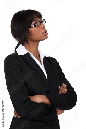 Businesswoman deep in thought