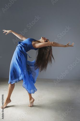 Dancer posing in ornate gown