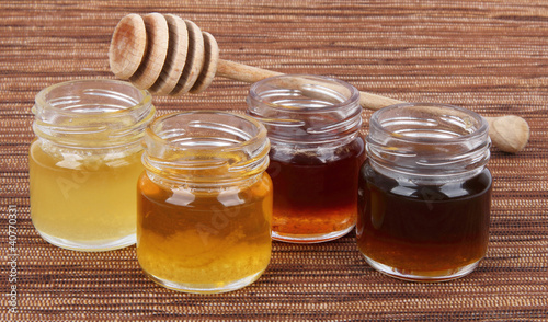 jars full of honey wooden stick, mix taste