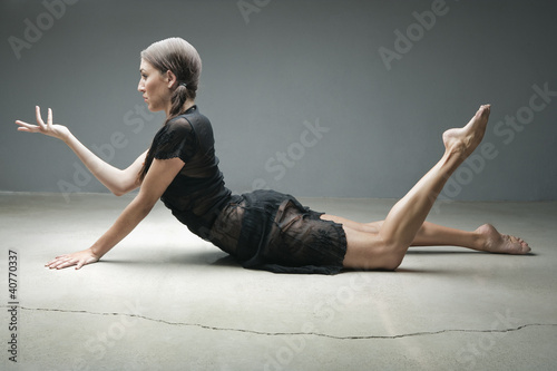 Dancer posing on floor